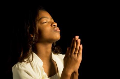young girl praying indoor
