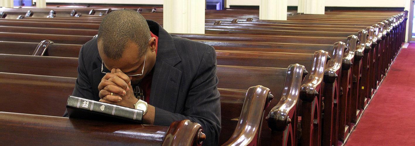 pastor praying in church
